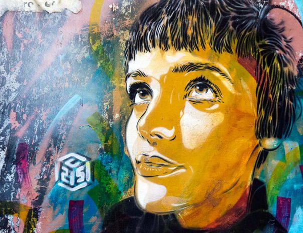 The street art tour in Malasaña visits an artwork by C215