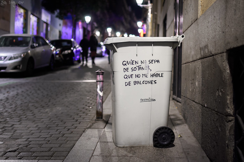 Picture of a trash can with street art