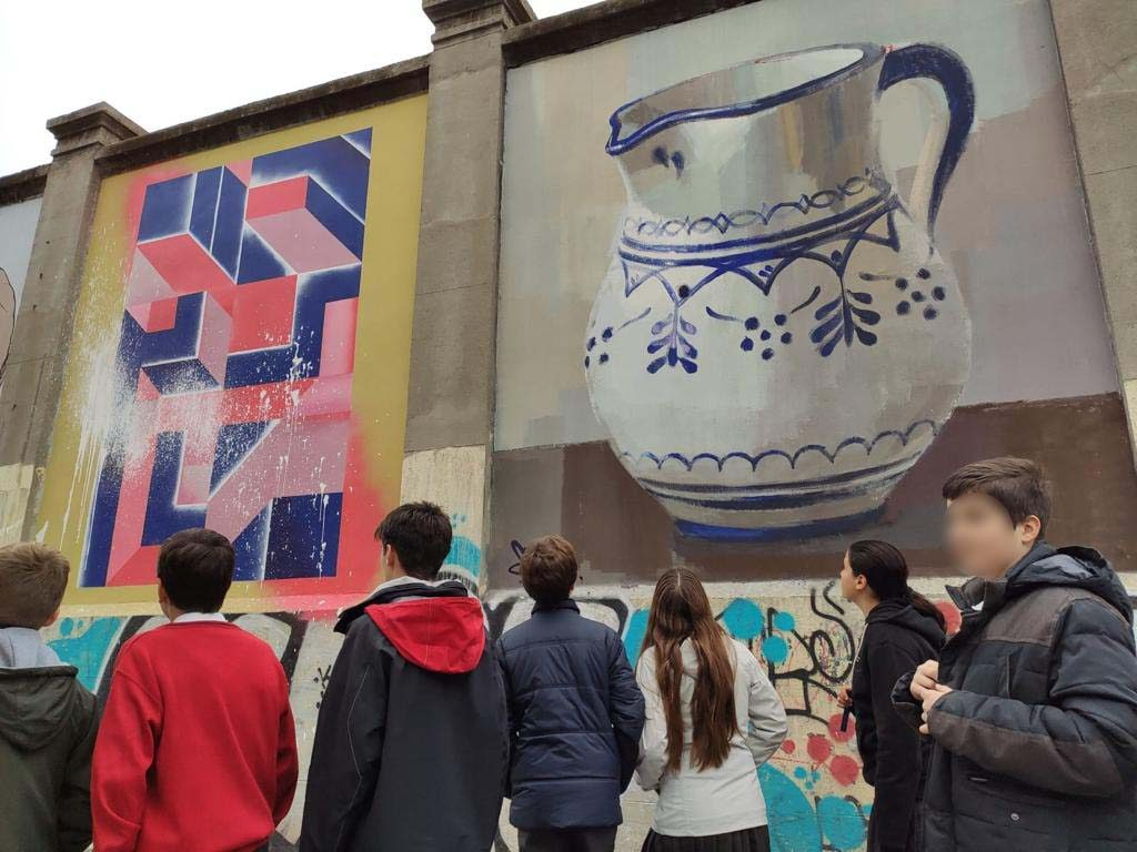 Students participating in a unique Madrid graffiti tour