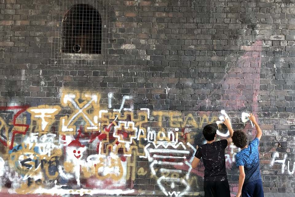 Kids participating in a graffiti art project