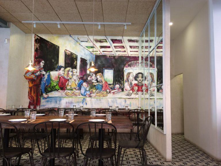 Italian restaurant with Ze Carrion artwork