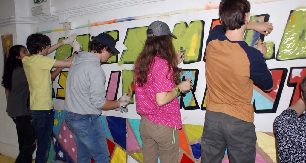 Teenagers participating at the graffiti workshop