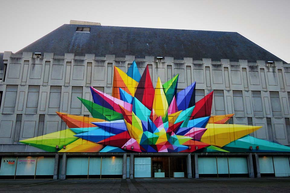 Graffiti created by Okudart in a building