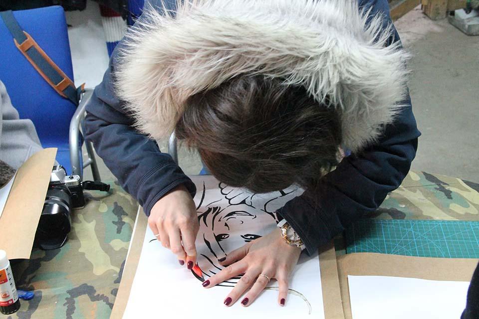guest cutting a stencil