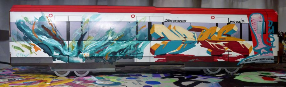 difference between street art and graffiti in a painted train