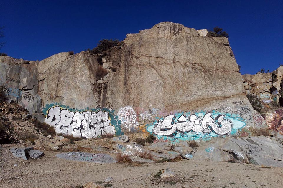 illegal graffiti in a mountain's walll